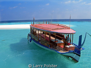 Dive boat, Angaga Island, beautiful clear waters by Larry Polster 